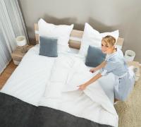Female-Housekeeper-Making-Bed